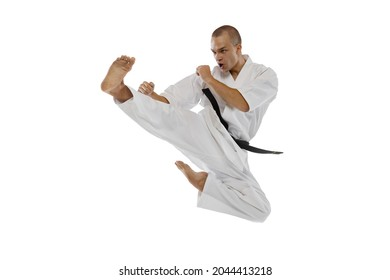 One caucasian sportsman training isolated over white background. Kick with leg in a jump. Karate, judo, taekwondo sport. Maintaining strength. Concept of martial art, combat sport, energy, fit, ad