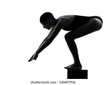 one caucasian woman competition swimmer on starting in silhouette studio isolated on white background