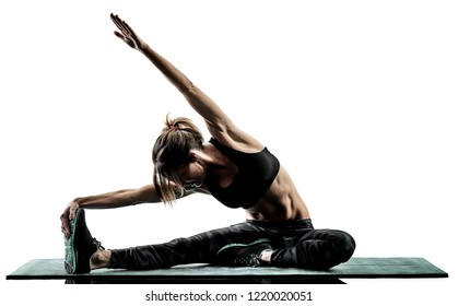 one caucasian woman exercising pilates fitness exercises isolated  silhouette on white background