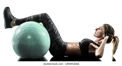 one caucasian woman exercising pilates fitness swiss ball exercises isolated silhouette on white background