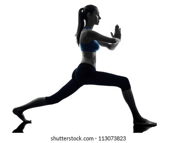 one caucasian woman exercising yoga warrior position in silhouette studio isolated on white background