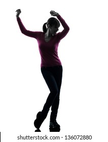 one caucasian woman happy dancing  in silhouette studio isolated on white background