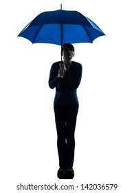 one caucasian woman holding umbrella  pouting in silhouette studio isolated on white background