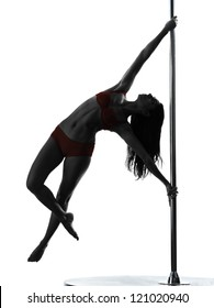 one caucasian woman pole dancer dancing in silhouette studio isolated on white background