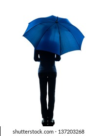 one caucasian woman rear view  holding umbrella  in silhouette studio isolated on white background