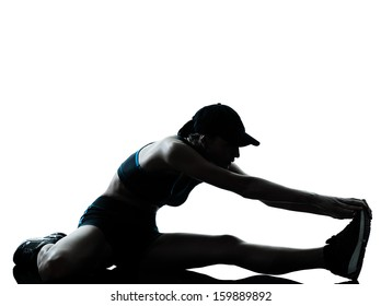 one caucasian woman runner jogger stretching legs warming up in silhouette studio isolated on white background