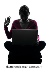 one caucasian woman saluting computing laptop computer  in silhouette studio isolated on white background
