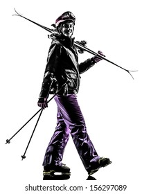 one caucasian woman skier walking in silhouette on white background