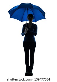 one caucasian woman smiling  holding umbrella  in silhouette studio isolated on white background