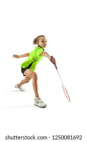 The one caucasian young teenager girl playing badminton at studio. The female teen player isolated on white background in motion