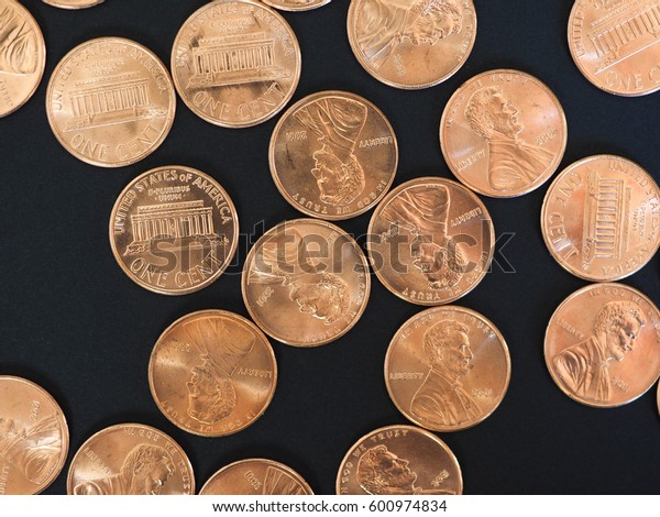 One Cent Dollar coins money (USD), currency of United States over black background