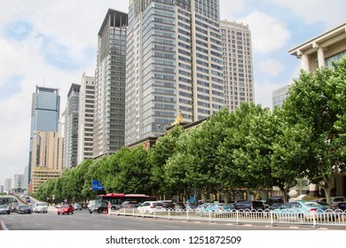 one of the central streets of the Chinese city of Dalian on a summer day. Street of metropolis. Travel in China. Dalian, China - august 12, 2018