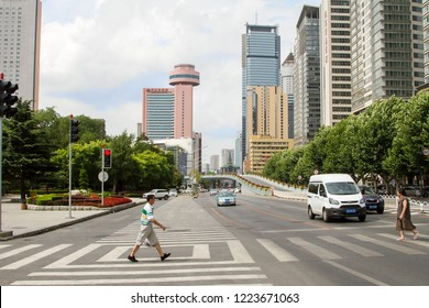 one of the central streets of Dalian on a summer day. cityscape of the city centre with street and skyscrapers in the background. Travel in China. Dalian, China - august 12, 2018