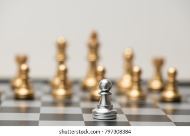 One  chess pieces staying against full set of black chess pieces