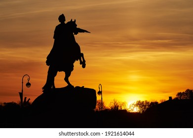 One of the city symbols - The Bronze Horseman, depicting Peter the Great. Backlit silhouette in sunset time.