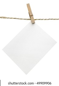 One clean sheet of paper on clothespin isolated on white background