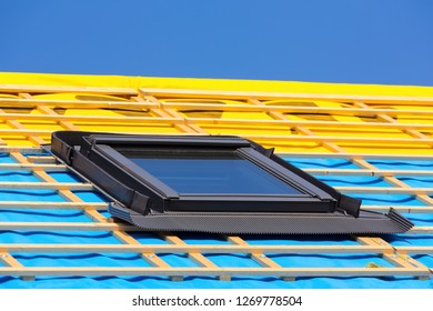 One closed new skylight on the roof of a new home