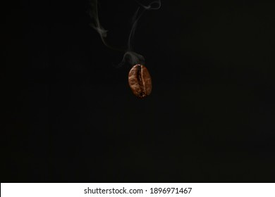 One Coffeebean with smoke in Macro view