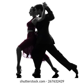 one  couple man woman ballroom dancers tangoing in silhouette studio isolated on white background