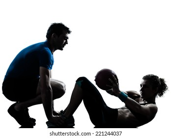 one  couple man woman personal trainer coach exercising weights fitness ball silhouette studio isolated on white background