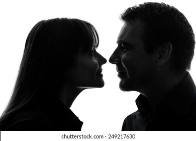 one  couple woman man in silhouette studio isolated on white background