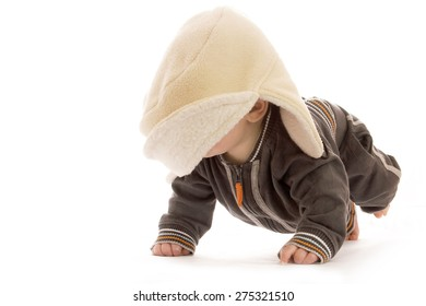 One cute little newborn baby in a hat on a white background