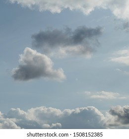 One dark cloud is rising behind the cloud nine. The two clouds in the middle are surrounded with a natural cloudy frame.
