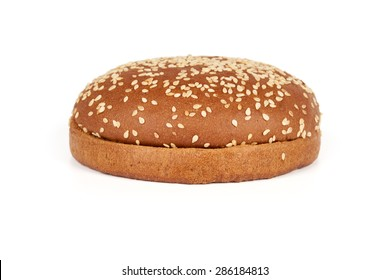 One dark hamburger bun with sesame seeds sliced in two halves isolated on white background