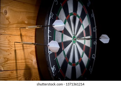 https://image.shutterstock.com/image-photo/one-dart-target-two-darts-260nw-1371361214.jpg