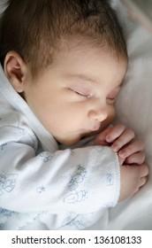 One day newborn in hospital bedroom.