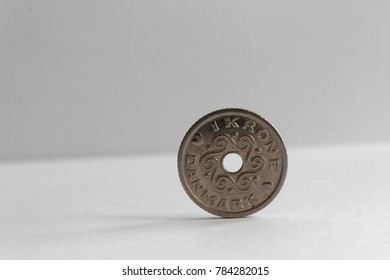 One Denmark coin lie on isolated white background Denomination is 1 krone (crown) - back side
