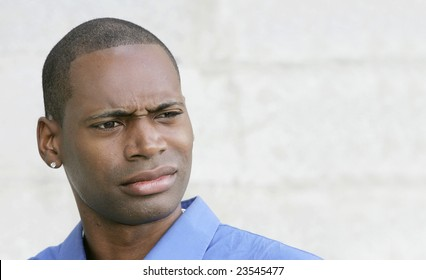 one disgusted looking shocked or surprised African American guy closeup portrait outdoors