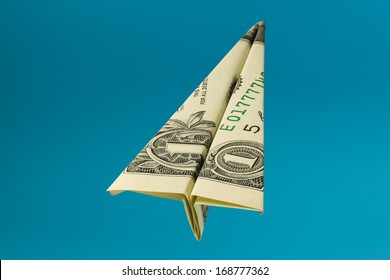 One Dollar Bank Note Airplane Over Blue Background Photo (with clipping path)