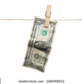 One dollar bill, banknote dry hanging on clothesline string with a clothespin, money laundering, isolated on white background