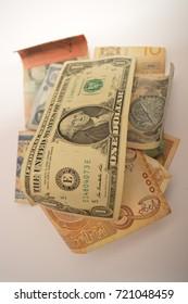 One dollar bill on others bills