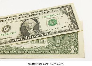 One dollar cash bills on white background
