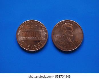 One Dollar cent (USD) coin, currency of United States (USA) over blue background