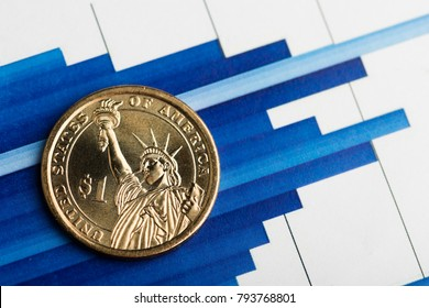 one dollar coin on fluctuating graph. Rate of the us dollar (shallow DOF)