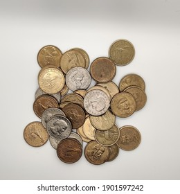 lot of one dollar and half a dollar coins isolated in white background