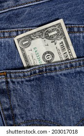 one dollar in jeans pocket