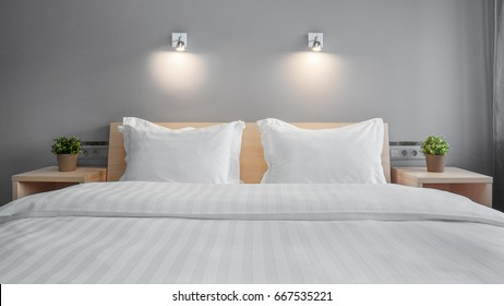 one double bed in a hotel near flowers on the nightstand