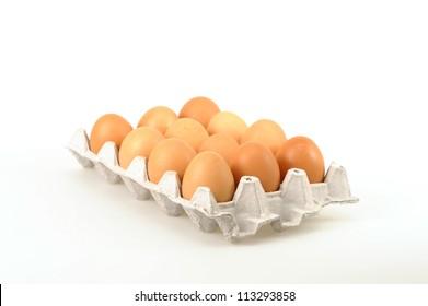 One dozen farm fresh eggs photographed on a white background.