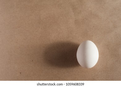One egg lies on the craft papper