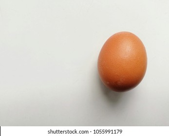 The one egg on the white background. Egg is a most ingredient for any menu around the world. Chicken egg have a lot of benefit can help you to diet. You can create a lot of menu from a little egg.