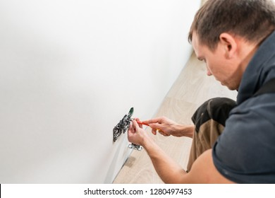 One electrician worker at wiring cable and light switch or power wall outlet socket installation work