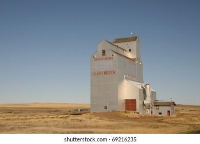 One of few remaining aluminum clad wooden prairie grain elevators on the Canadian prairies. This iconic prairie sentinel is abandoned at Glentworth Saskatchewan
