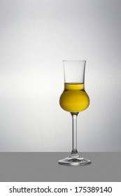 One filled Grappa glass