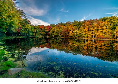"One fine evening at Park entrance of ""Bushkill"" falls - The Niagara of Pennsylvania U.S.  Anyone visiting the falls at autumn will loose their time in this scenic pond."
