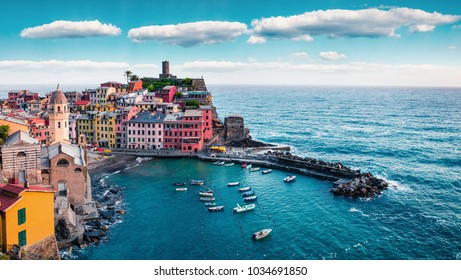 One of the five towns that make up the Cinque Terre region - Vernazza. Aerial spring view of Liguria, Italy, Europe. Picturesque seascape of Mediterranean sea. Traveling concept background.