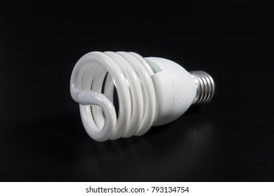 One fluorescent light bulb in the dark room on black background for energy saving concept. Energy saving light bulb for thinking idea.